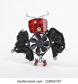 cute funny robot toy made of garbage. recycling waste