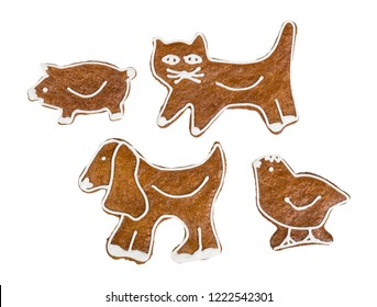 Cute gingerbreads in kitty, doggy, piggy, and chicken shape. Set of sweet Christmas cookies decorated by icing. Xmas, New year, Children's day, birthday celebrations. Isolated on white background.