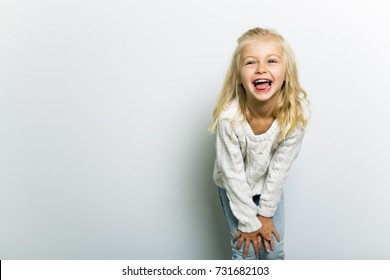 Cute girl 4-5 year old posing in studio