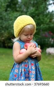 Cute girl with apples in her hands