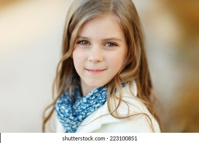 Cute girl in autumn portrait