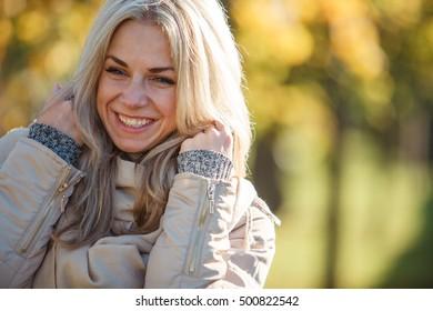 Cute girl in autumn sunny day