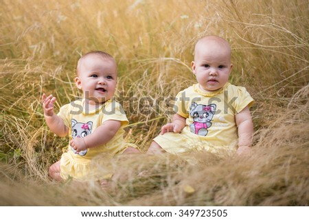 Cute Girl Baby Twins Seating Golden Stock Photo (Edit Now) 349723505 ...