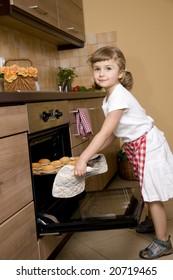 Cute girl baking muffins