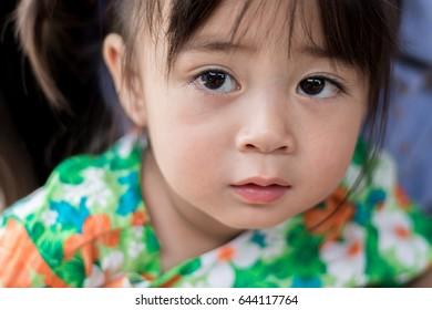 Cute girl with big eyes sad.