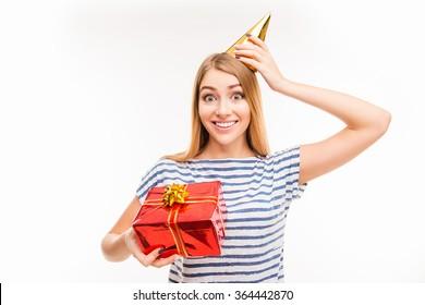 Cute girl in birthday cap holding present
