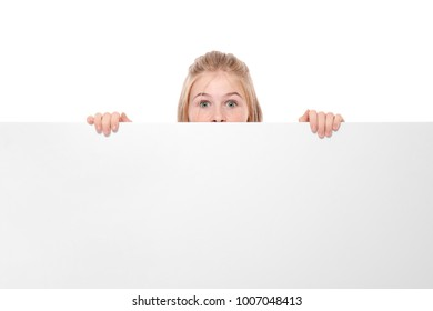Cute girl with blank advertising board on white background