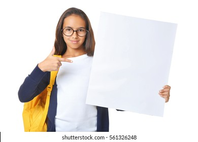 Cute girl with blank poster on white background