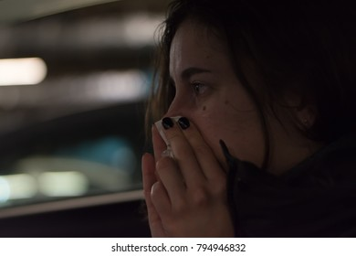 Cute girl blowing one's nose in the car