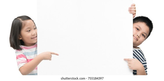 cute girl and boy pointing on white banner board isolated on white background with copy space for input text