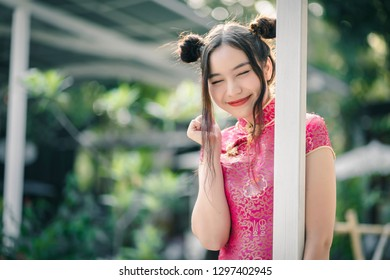 Cute girl with cheongsam traditional Chinese dress on Chinese new year.