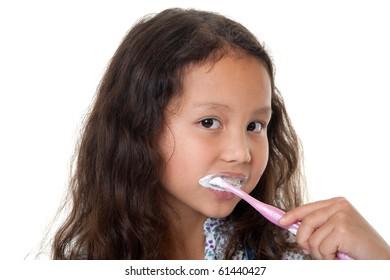 Cute girl cleans teeth