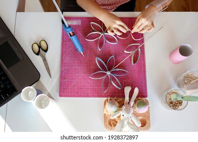 Cute girl doing flowers with toilet roll tube for Easter and Mother Day via online master class, zero waste crafts for kids, school and kindergarten, creative idea for holidays from internet