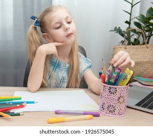 Cute girl doing homework in her room at home