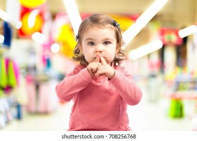 Cute girl doing silence gesture