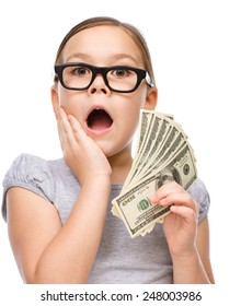 Cute girl with dollars, isolated over white