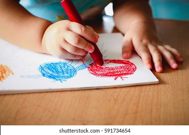 cute girl drawing with colourful crayon ,kids Coloring