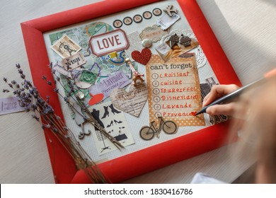 Cute girl dreaming about travel to France and creating mood board with sheets of paper, pictures, words, positive thinking and dreams map, indoor lifestyle