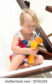Cute girl drinking orange juice