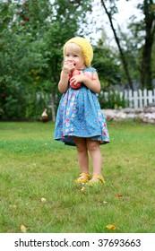 Cute girl eating fresh apples
