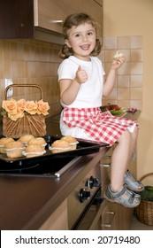Cute girl eating muffins