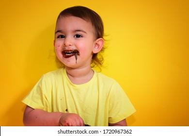 cute girl eats delicious chocolate