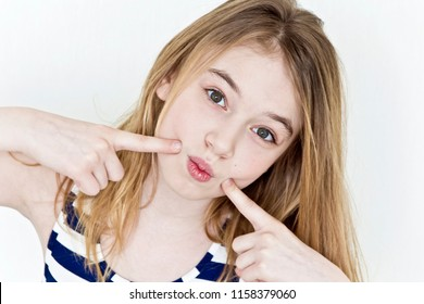 Cute girl eleven years old with blond long hair on white background