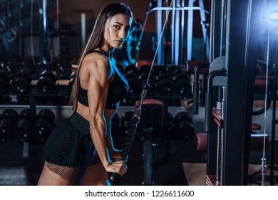 cute girl is engaged in the gym.young woman making exercise at the gym