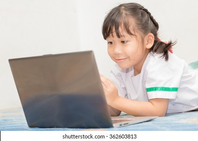 cute girl enjoy to play computer.