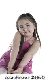 Cute girl of five stretching her bare arms