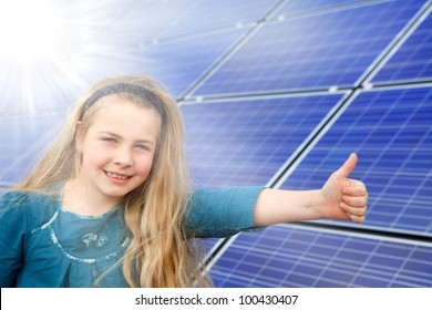 cute girl gives thumbs up for photovoltaic cells