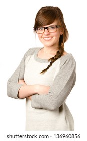 Cute Girl With Glasses - This is a photo of a cute young girl with glasses and braided hair smiling at the camera in a comfortable sweatshirt. Shot on an isolated white background.