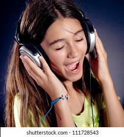 Cute girl with headphones singing.