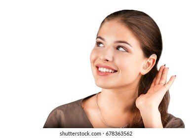 Cute girl with hearing aid looks aside and smile. At isolated white background.