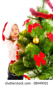 Cute girl helping to decorate Christmas tree