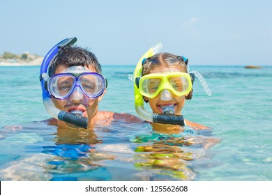 Cute girl with her father snorkelling swimming in the transparent sea