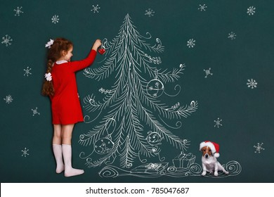 Cute girl and her jack russell dog with decorates a Christmas tree. 2018 holiday concept.