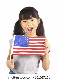 Cute girl holding an American Flag