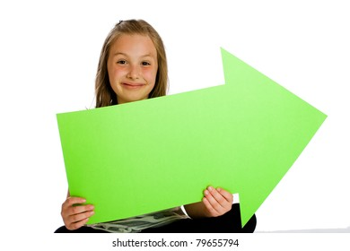 cute girl holding a blank green sign in the shape of an arrow.