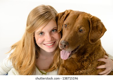 Cute girl holding a dog over white background