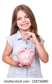 Cute girl holding pink piggy bank