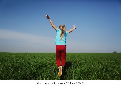 Cute girl jumping in the field