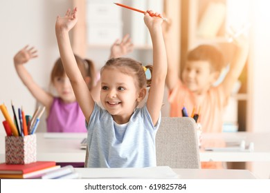 Cute girl at lesson in classroom