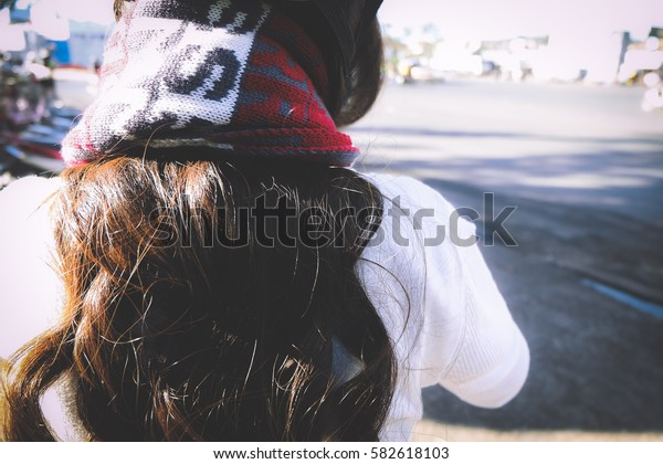Cute girl with long hair back side