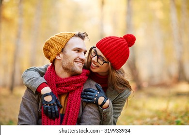 Cute girl looking at her boyfriend while embracing him