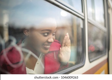 Cute girl looking out from a train's window