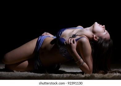 cute girl lying on a carpet in eastern dress