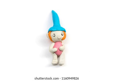 Cute girl made by clay sculpting isolated on white background