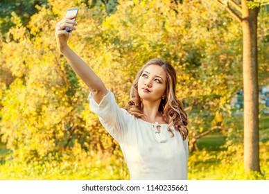 Cute girl making a selfie in a park