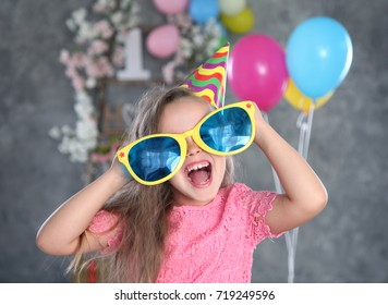 cute girl on birthday party